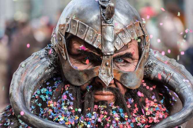 man wearing viking helmet focus photography