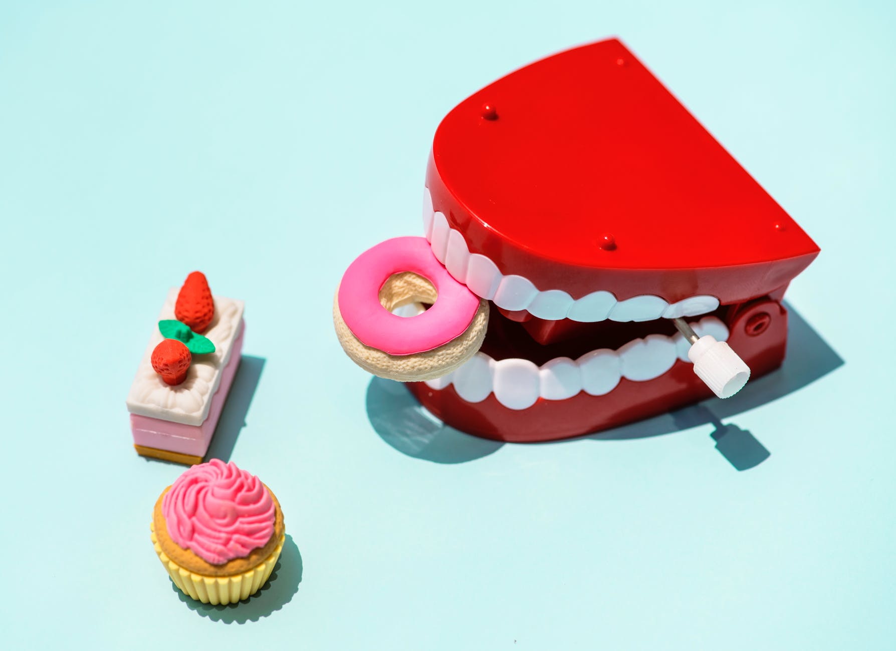 red and white mouth plastic toy and food plastic toys